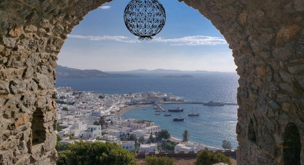 view of Mykonos port through stone gate