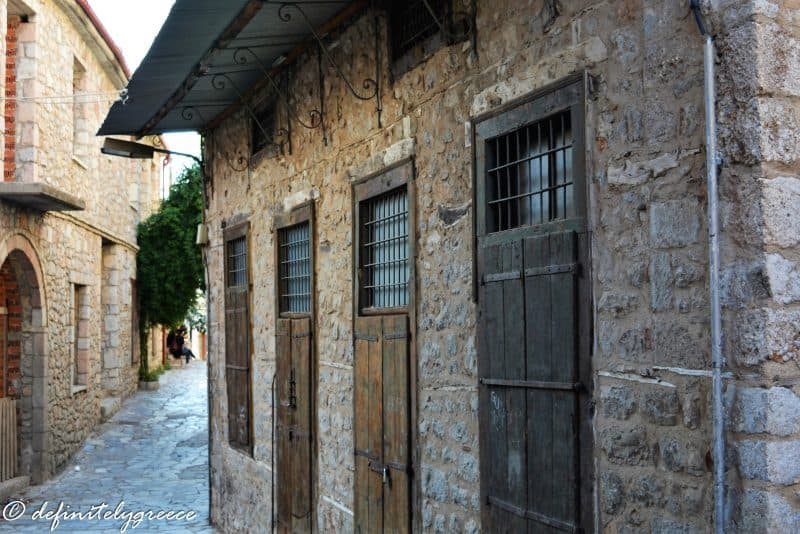 narrow cobbled street and stone houses in arahova - small mountain village - welcome to central Greece