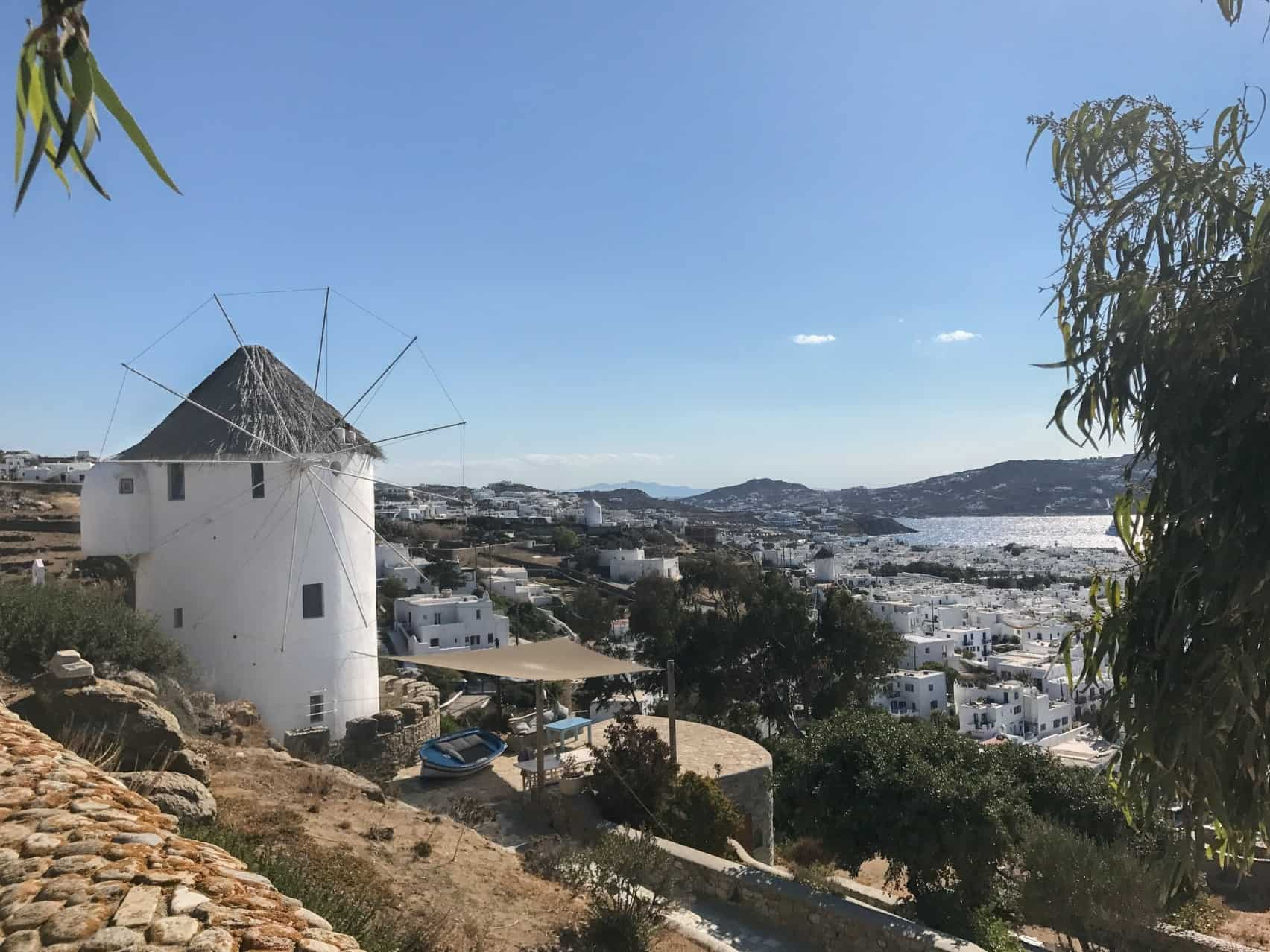 best places to visit in greece windmill and view of mykonos - greece