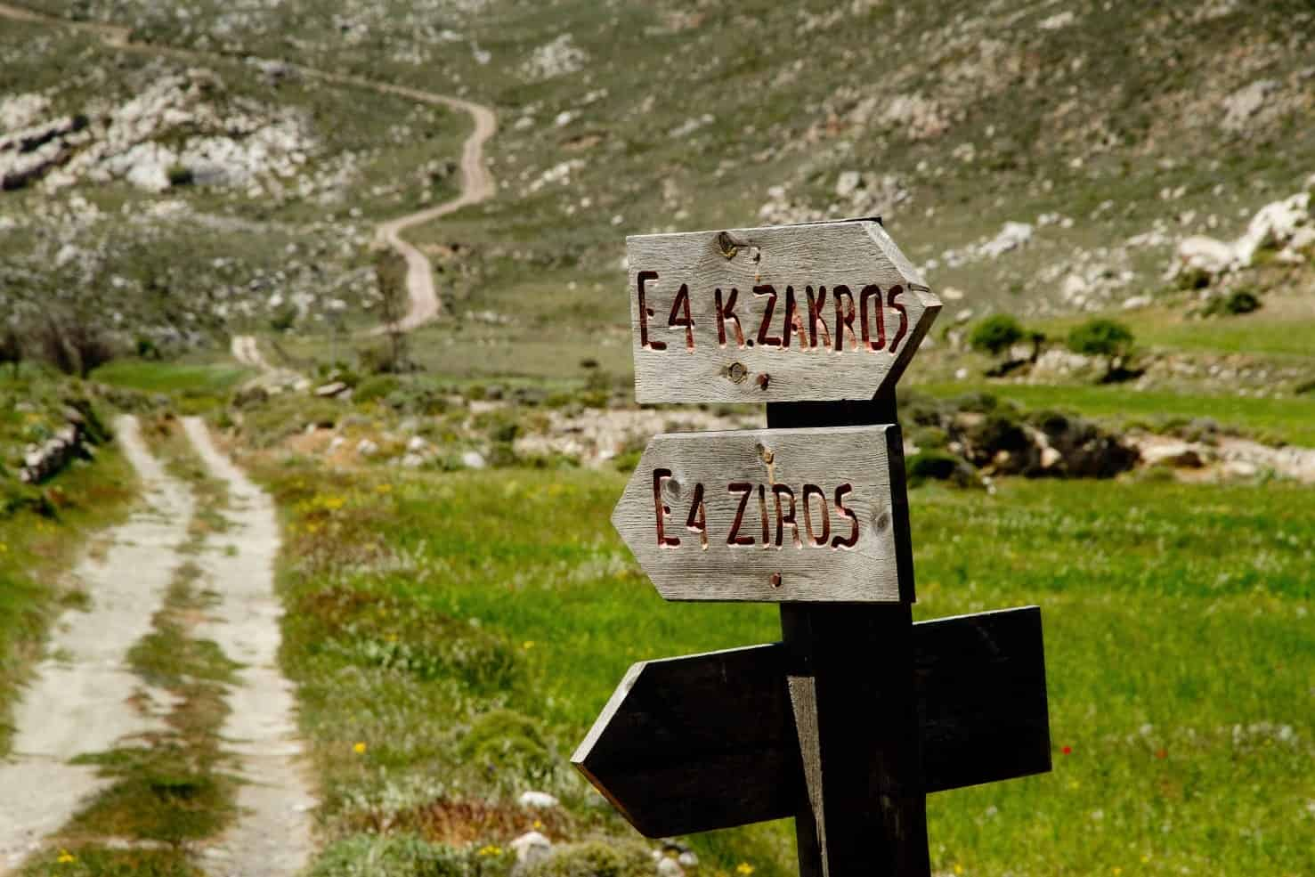 two wooden sings on a pike - trails of crete island - activities - nature lovers - definitely greece tours