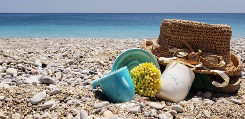 Women Travel Groups Greece - flower hat and blue cup on a beach in Kythira Island