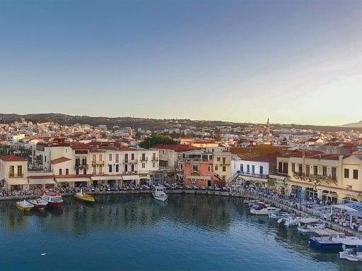 crete - photo of rethimno harbour - dusk - boats and tavernas