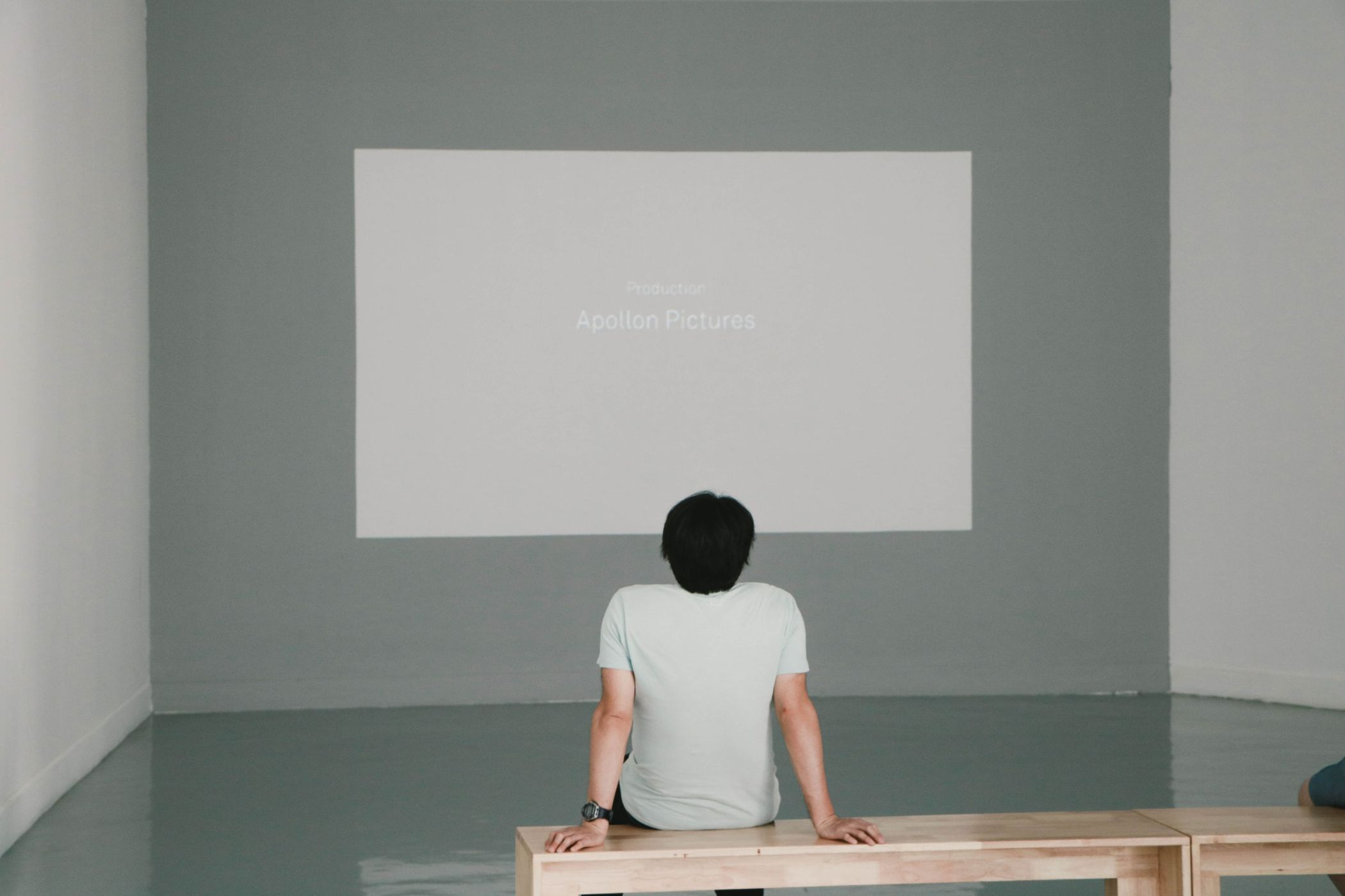 Movies in Greece boy infront of projector