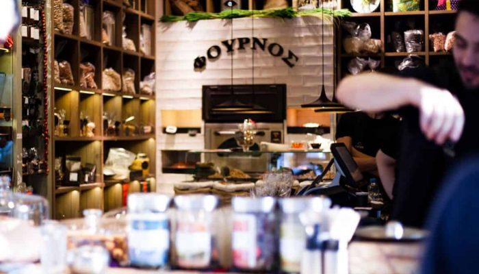 barista in Athenian coffee shop Greece