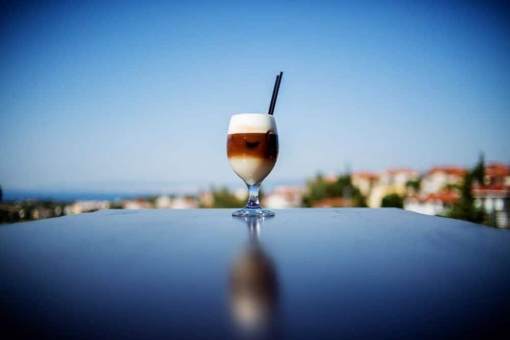 glass with freddo cappucino on sky backdrop in Greece Thessaloniki