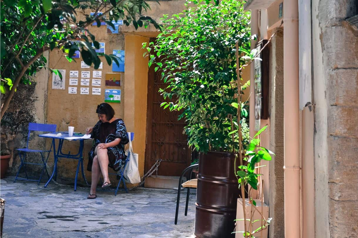 lady reading newspaper crete Chania Greece things to do