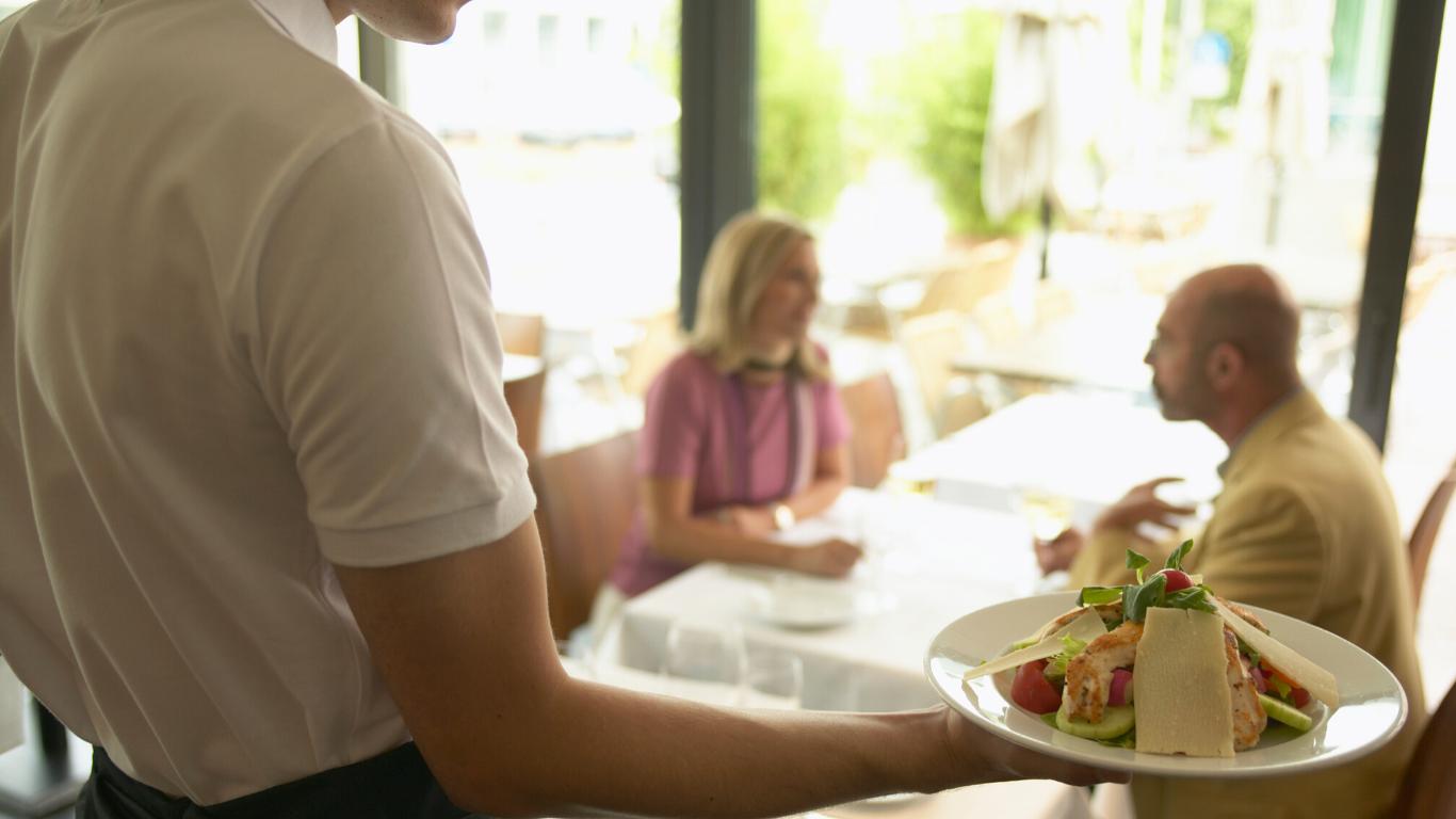 waiter-serving-food-canva
